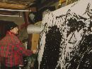Thomas Delohery working on a large canvas in his old studio in Clare.