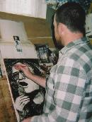 Thomas Delohery working on a Harris piece in his old studio in Clare.