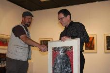 Artist Thomas Delohery presenting a Painting to the Jewish Holocaust Centre Melbourne